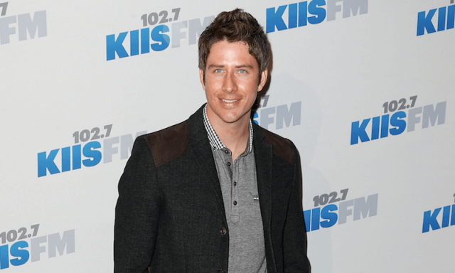 Arie Luyendyk Jr posing on a red carpet.