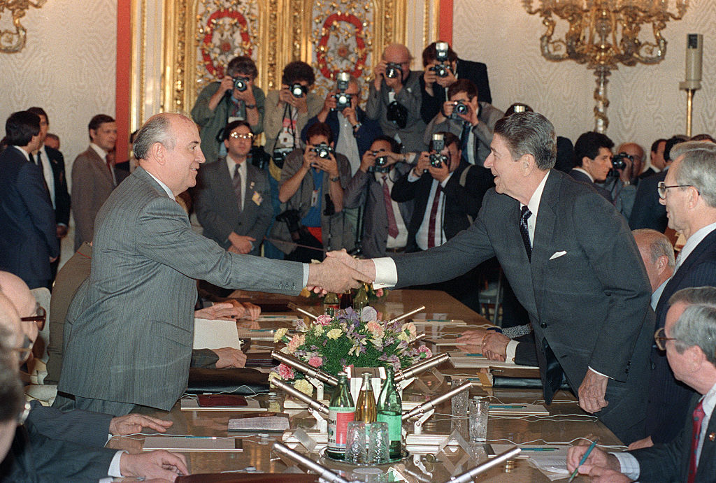 US President Ronald Reagan shown in a photo shaking hands with Soviet leader Mikhail Gorbachev