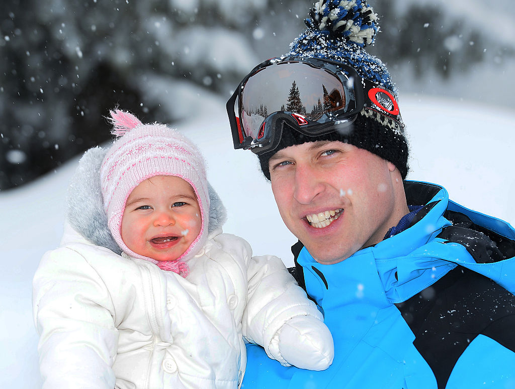 Prince William, Duke of Cambridge poses with his daughter Princess Charlotte during a private break skiing