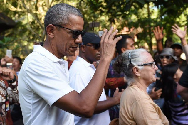 President Obama greeting tourists in Indonesia.