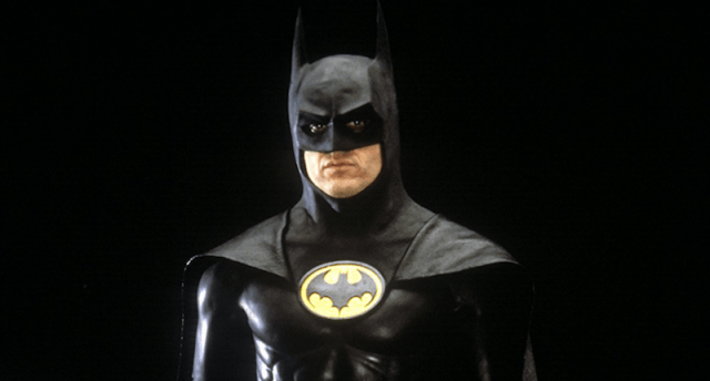 Batman standing in front of a black background.