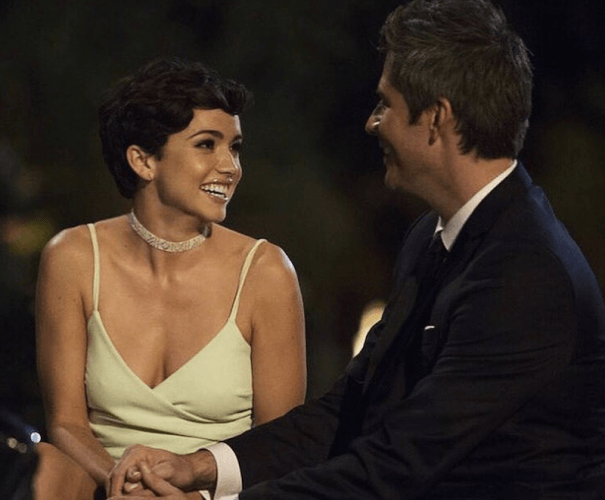 Bekah Martinez smiles as she stares at Arie.