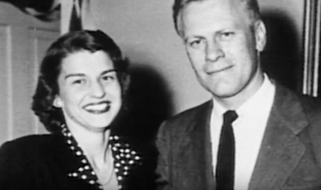 Betty and Gerald Ford standing and smiling together.