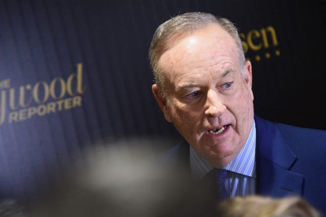 Bill O'Reilly speaking in front of a crowd.