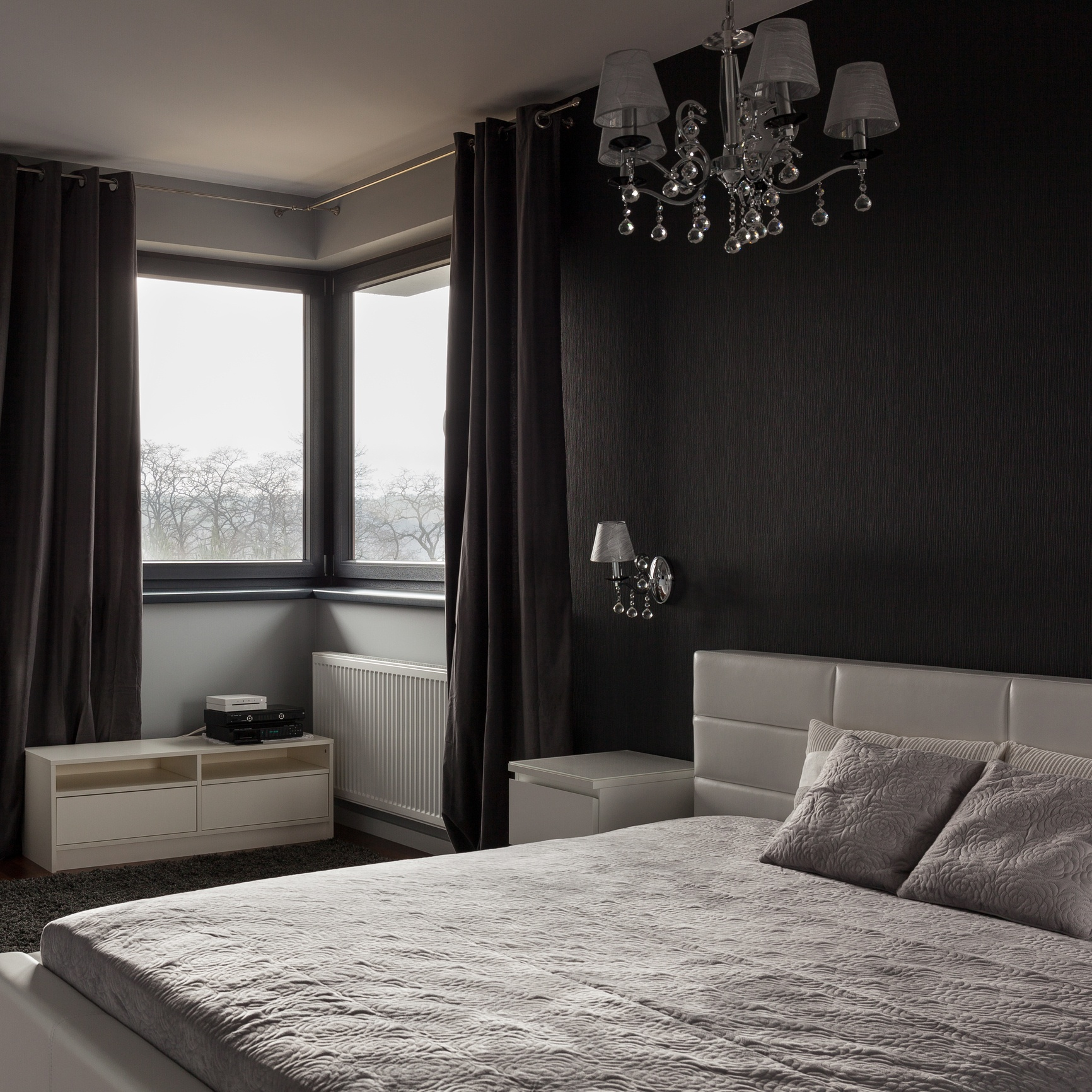 Dark bedroom with black accent wall
