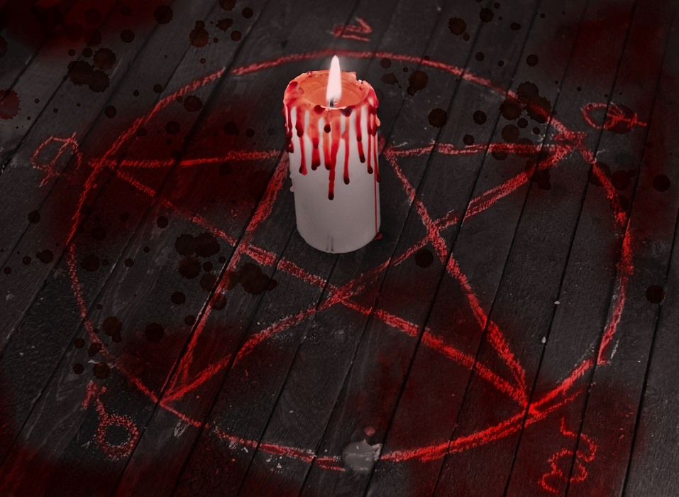 Scary Halloween collage with black candle, blood drops and pentagram circle on wooden table