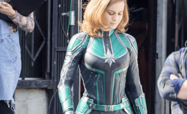 Brie Larson walks on set while filming a scene.