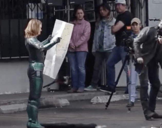 Brie Larson holds a map on set while filming a scene for the movie.