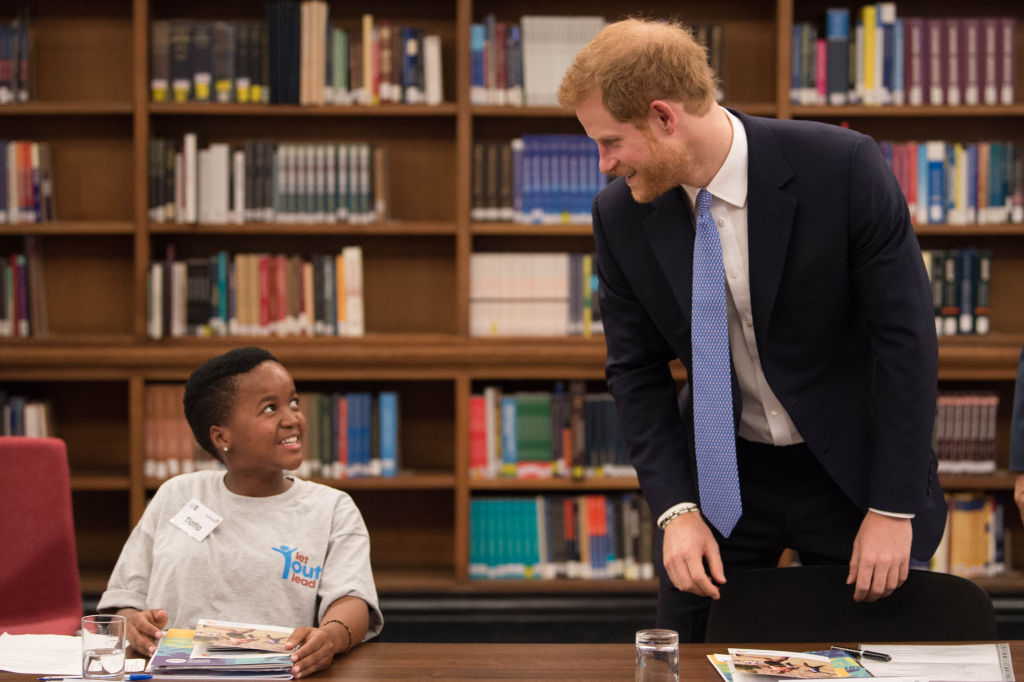 Britain's Prince Harry (R) meets Tlotlo Moilwa from Botswana