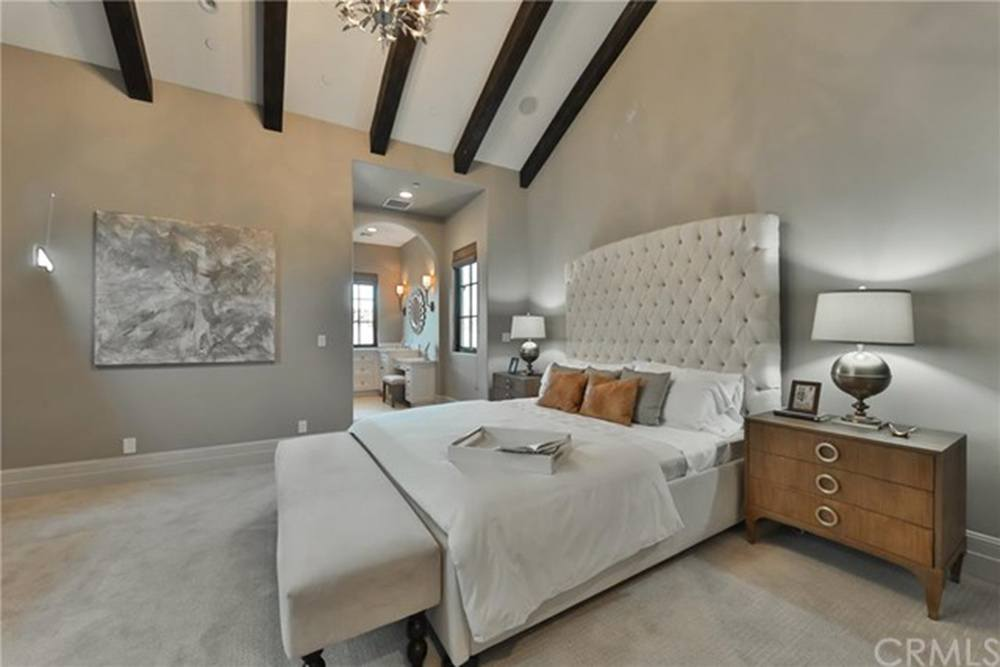 Britney Spears' guest bedroom with high ceilings with beams