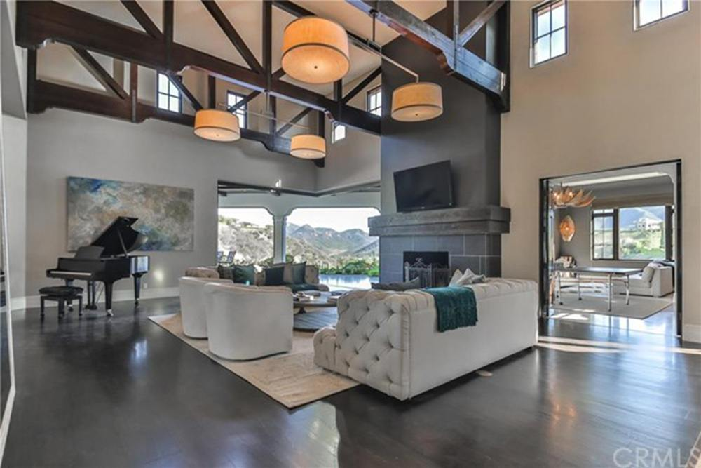 Britney Spears' living room with high ceilings and fireplace