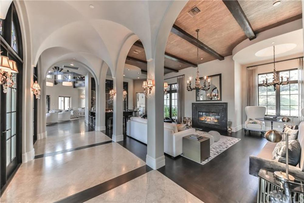 Britney Spears' living room with arched openings and a fireplace