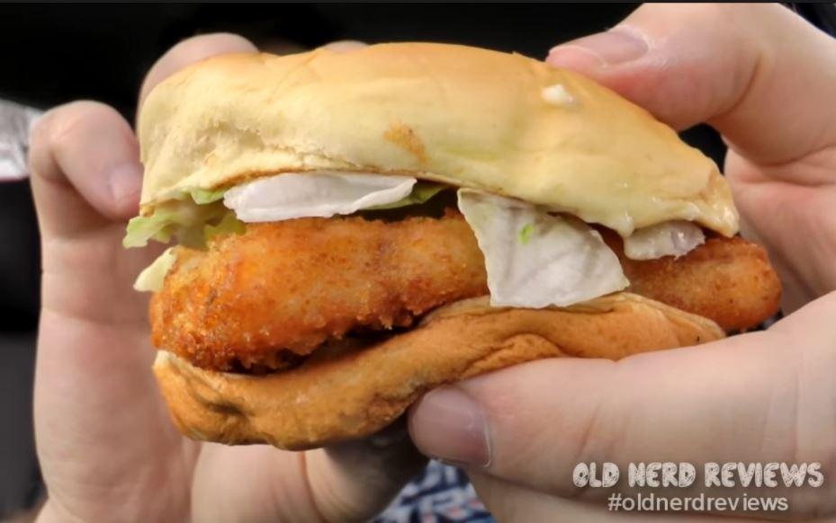 A man holds a Burger King fish sandwich