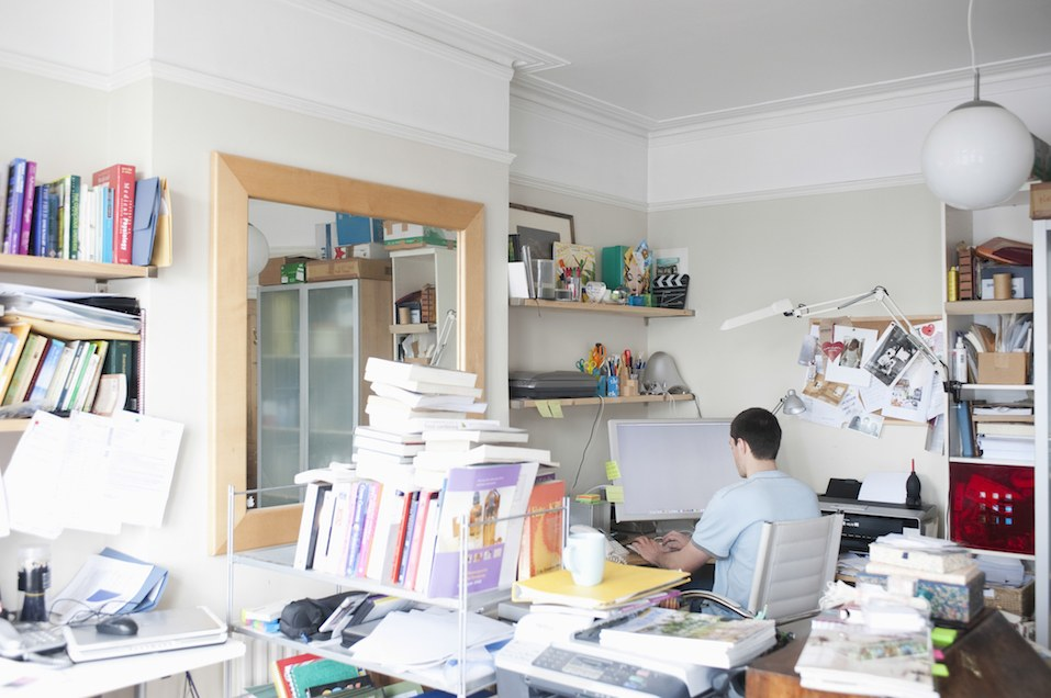 Businessman Using Computer In Home Office