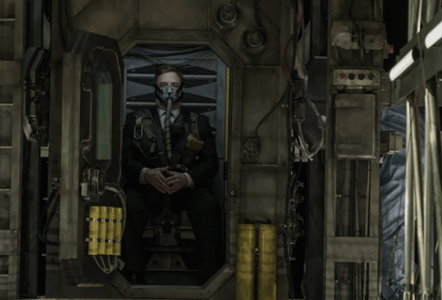 John Goodman wearing a face mask and tube in 'Captive State'.