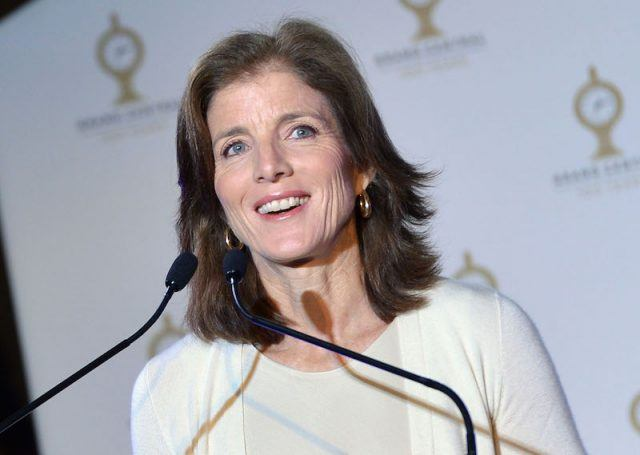 Caroline Kennedy smiling from behind a podium.