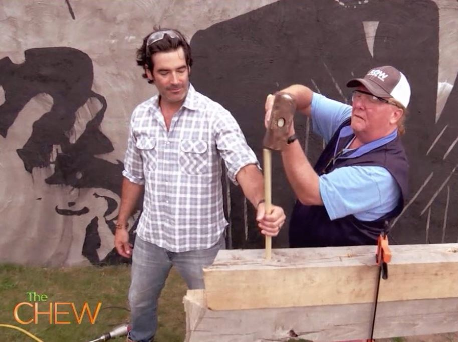 Carter Oosterhouse and chef Mario Batali work on a house project