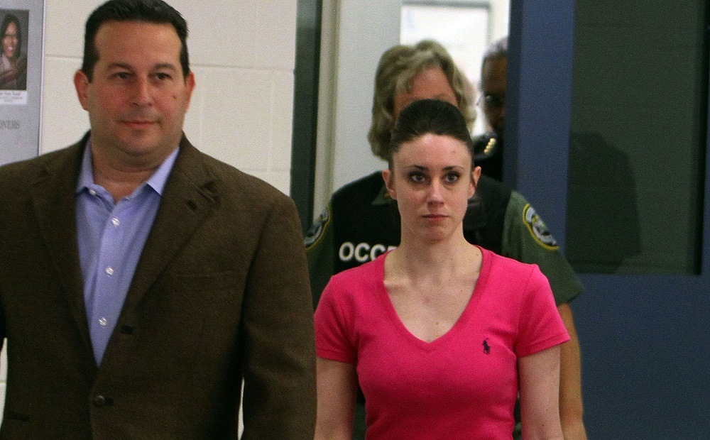 Casey Anthony (R) leaves with her attorney Jose Baez