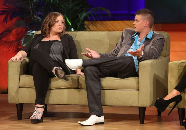 Catelynn and Tyler sitting on a sofa during an interview.