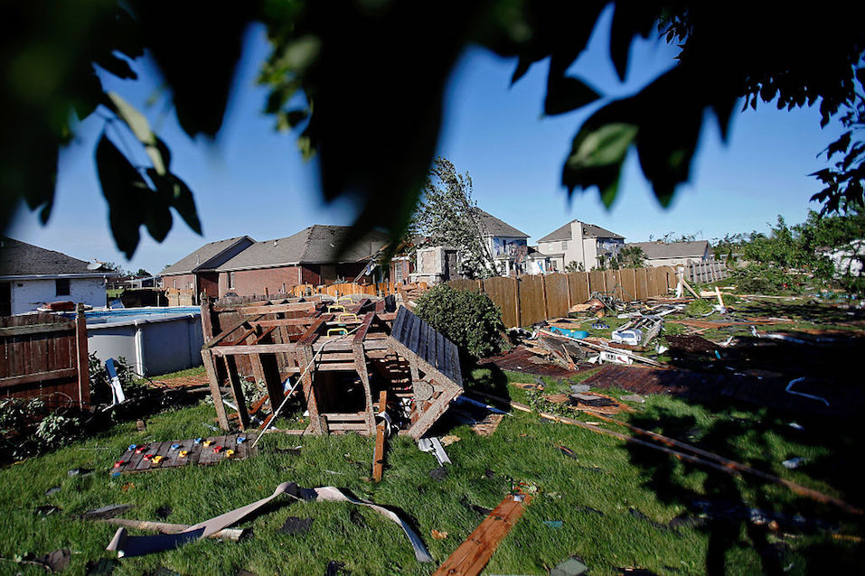A playground set lays on the ground in the backyard of a home on W. Daisy Place