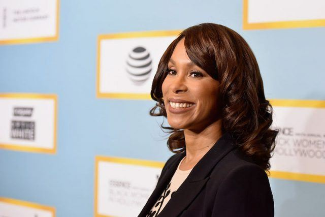 Channing Dungey smiling at a media event.