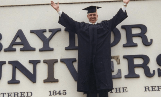Chip Gaines in a graduation gown.