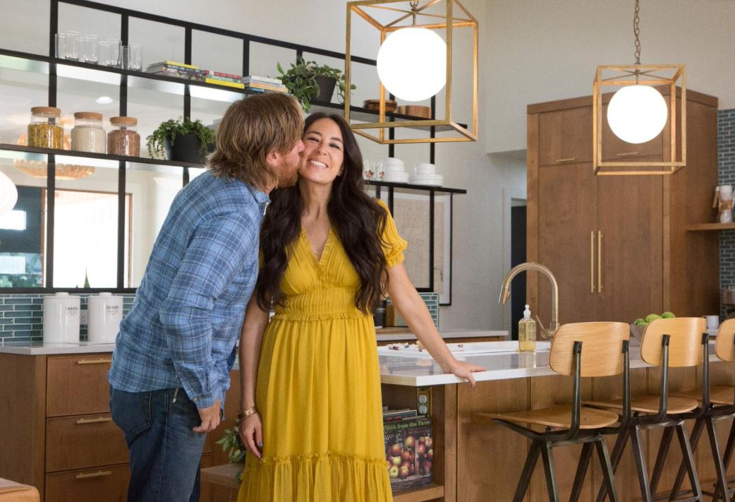 Chip and Joanna Gaines stand in a fully renovated kitchen.