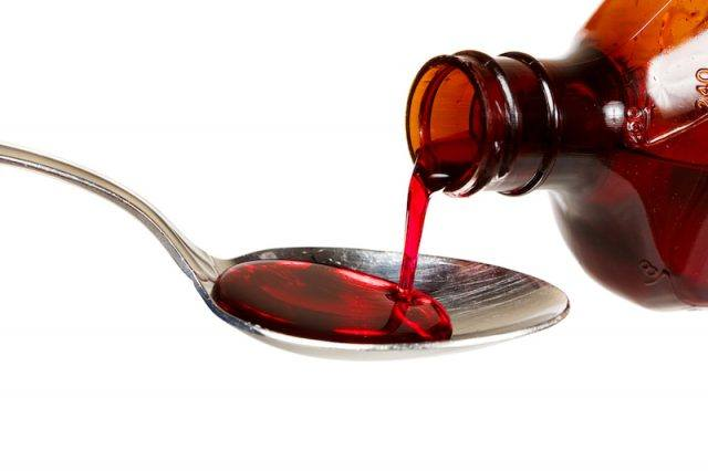 Syrup being poured onto a spoon.