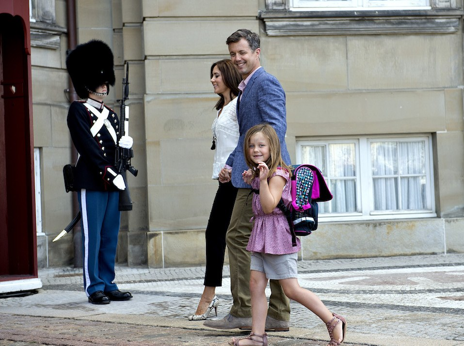 Danish Princess Isabella waves as she leaves with her parents Crown Prince Frederik and Crown Princess Mary at Amalienborg Palace in Copenhagen.