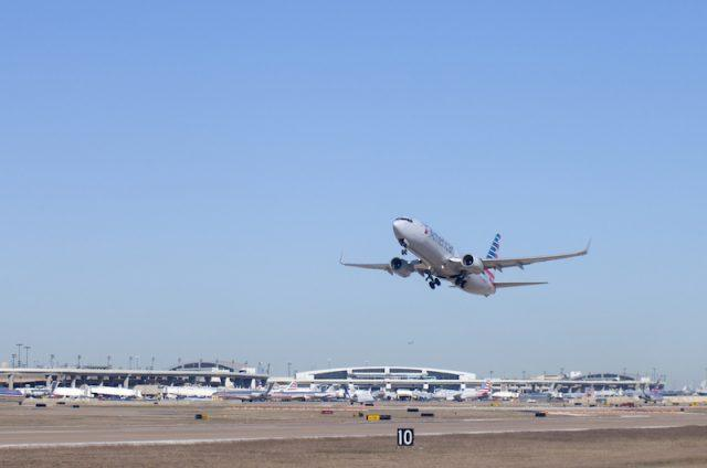 An airplane departing from an airport.