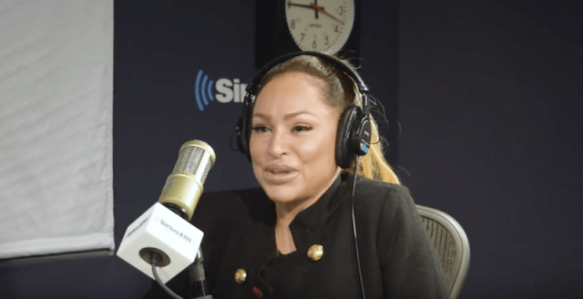 Darcey Silva in front of a microphone during a radio interview.