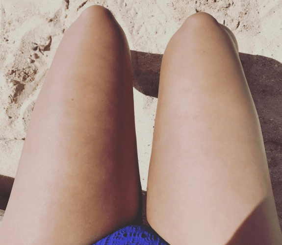 Demi Lovato's thighs on a sandy beach.