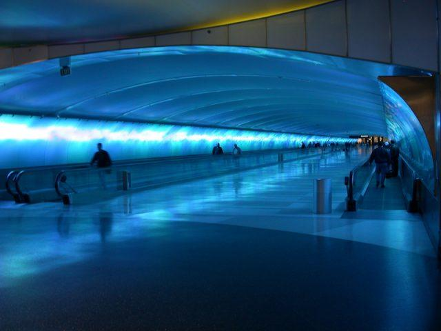 Travelers passing through the Detroit Metropolitan Airport.