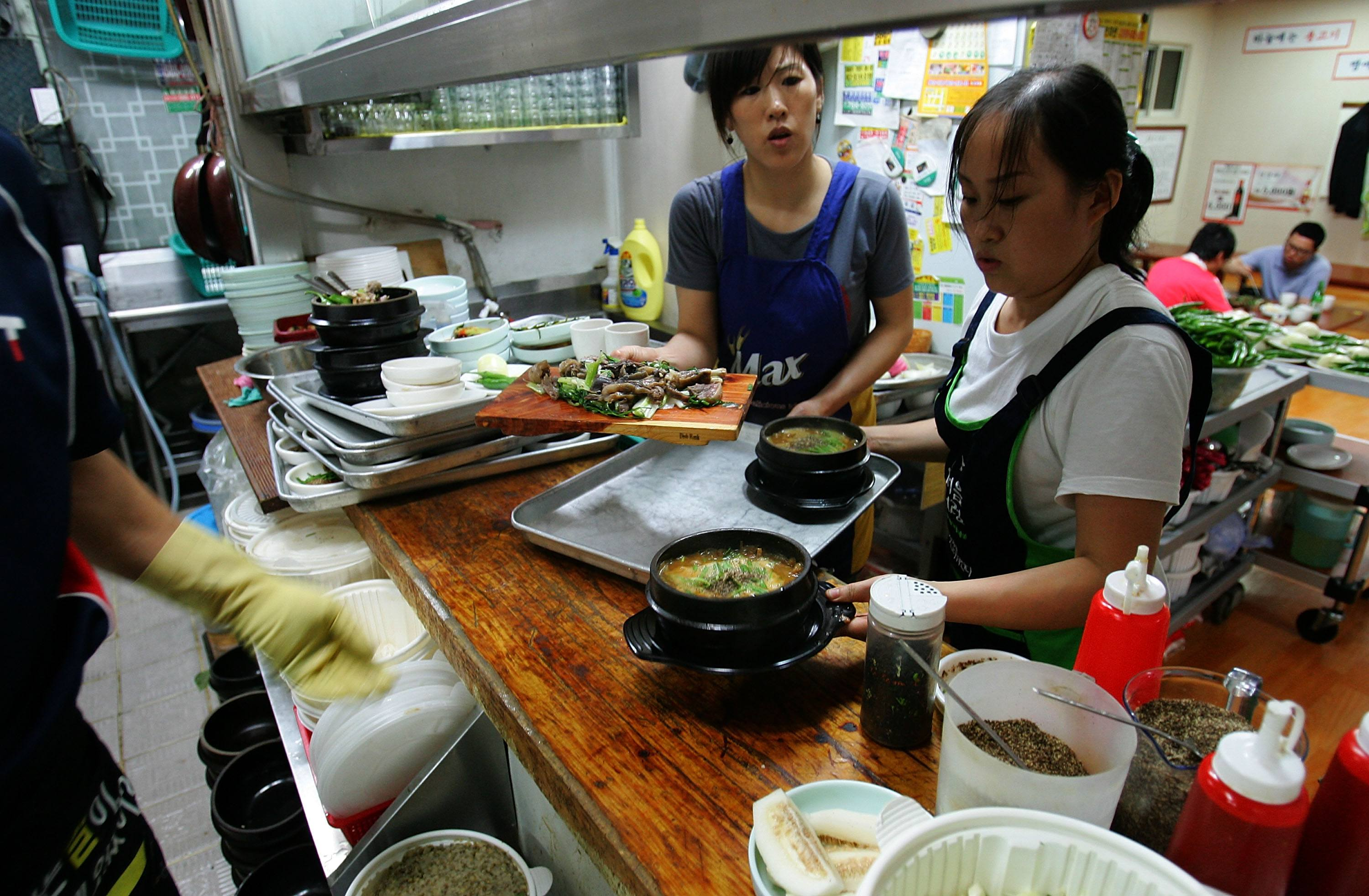 Chef with dog meat stew