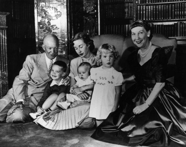Dwight Eisenhower and his family in a library.