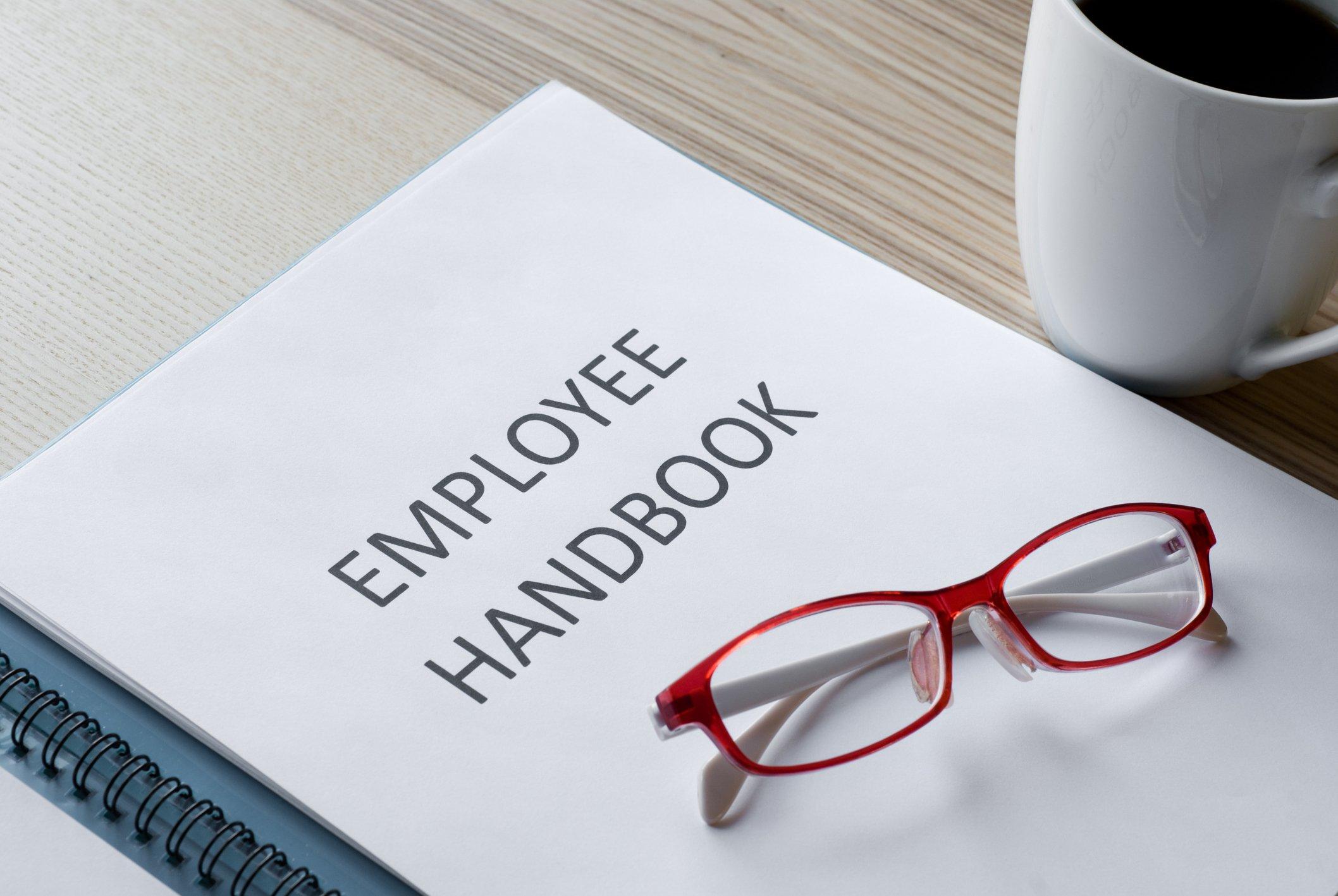 employee handbook on the table