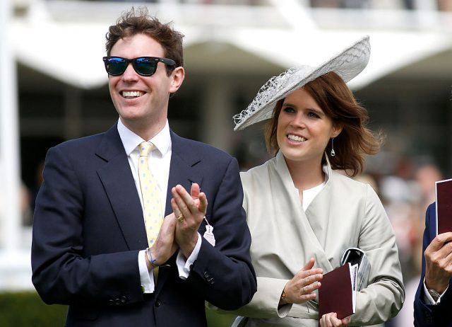 Jack Brooksbank and Princess Eugenie of York at at outdoor event.