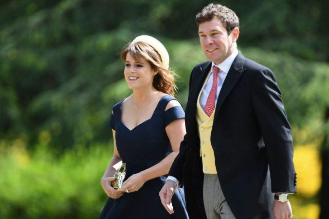 Jack Brooksbank and Princess Eugenie of York walking together.