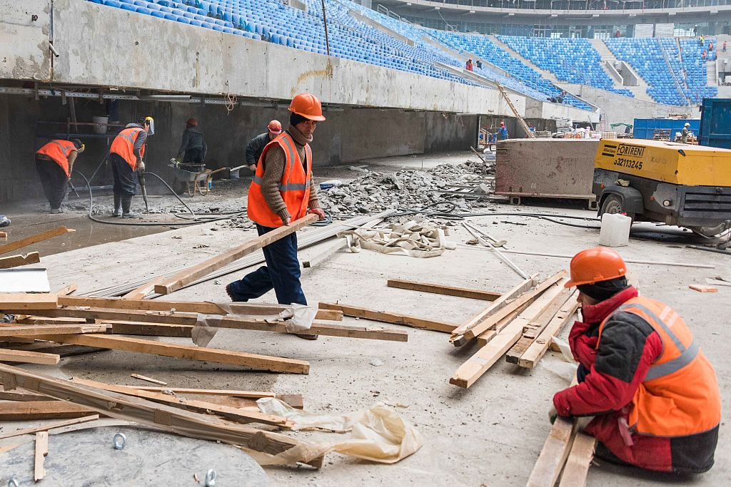 Workers at the Saint-Petersburg Stadium during construction works