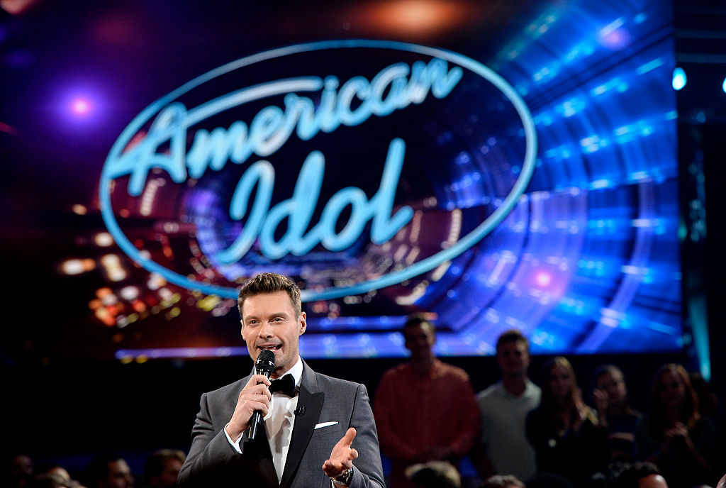 Host Ryan Seacrest speaks in the audience during FOX's 'American Idol' Finale For The Farewell Season