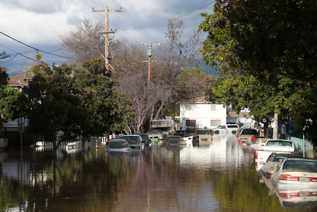 Cars are seen in floodwaters in San Jose, California