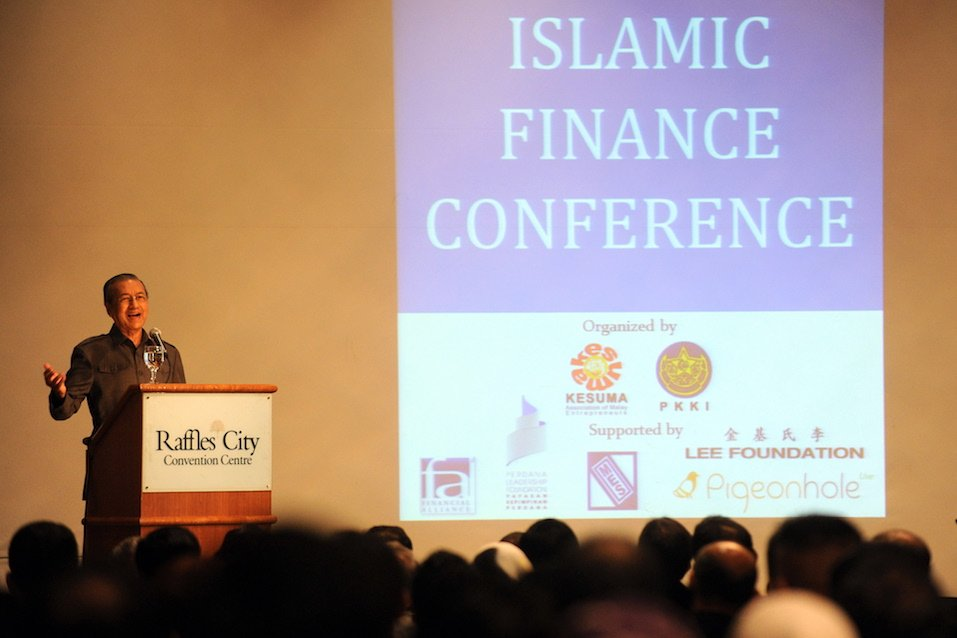 Former Malaysian prime minister Mahathir Mohamad gestures as he speaks at an Islamic finance conference in Singapore