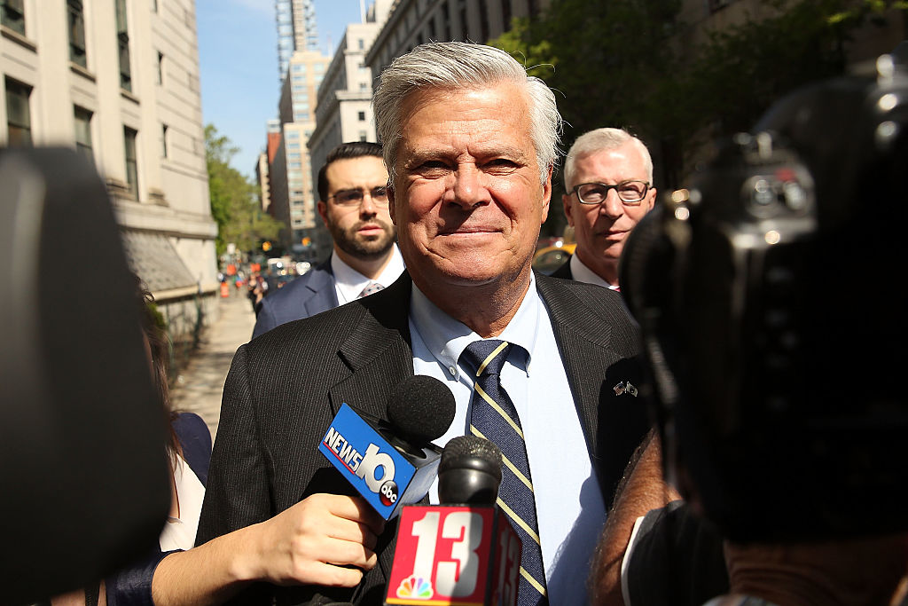 Former New York State Senate Majority Leader Dean Skelos walks into a Manhattan court for his sentencing