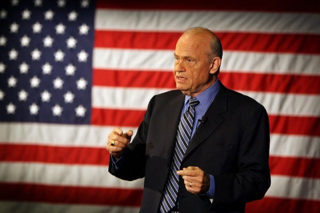 Fred Thompson speaking in front of the American flag.