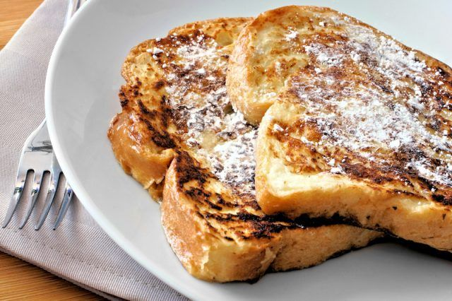 French toast on a white plate.