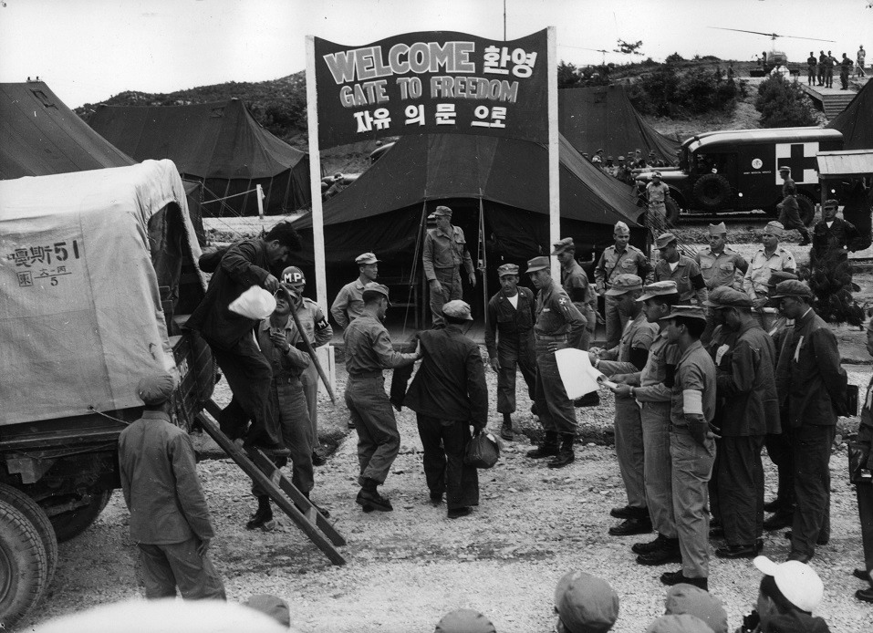 An exchange of prisoners between the United Nations and the Communists at Panmunjom, Korea