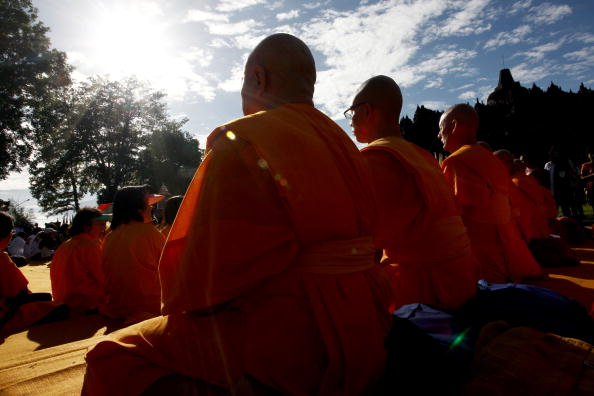 Buddhist monks meditating for happiness