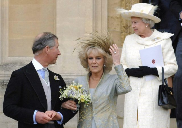 Prince Charles and Camila Parker Bowles walking in front of the queen.