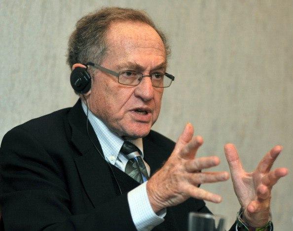 Harvard law professor Alan Dershowitz speaking to a crowd.