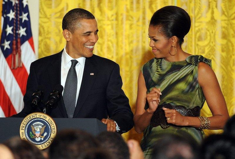 U.S. President Barack Obama speaks as First Lady Michelle Obama looks on du